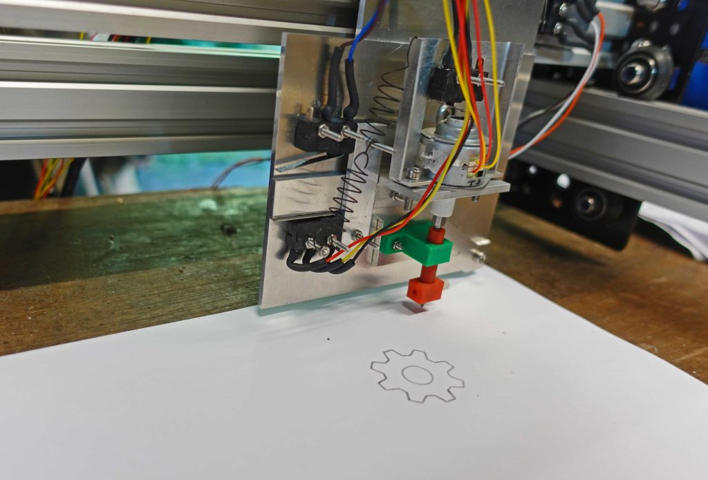 laser cutter drawing head showing springs